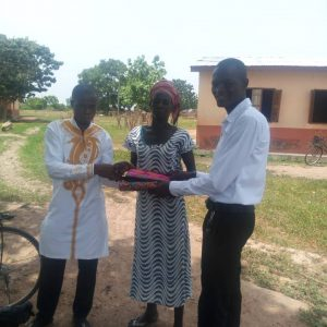 Donation of clothes to widows in Kofi Basare Bono district Ghana.