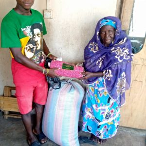 rice and oil to some widows in Buma Northern region ghana, picture 3 food maize and 200ghs to a widow in Yeji